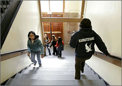 High school students in Boston rush to get to class. Boston switched control of its school system from an elected board to one appointed by the mayor 15 years ago.