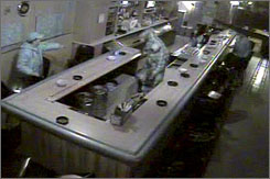 An image from the surveillance video shows an off-duty police officer punching a woman about half his size.