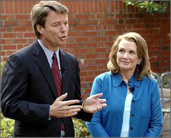 2008 candidate John Edwards, left, with his wife Elizabeth, on Thursday in Chapel Hill, N.C.