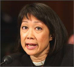Carol Lam, a former U.S. attorney, testifies March 7 before the Senate Judiciary Committee.