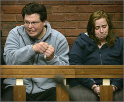 Michael Riley, 34, and his wife, Carolyn, 32, are shown in Hingham District Court during their arraignment, in this Feb. 6, 2007, file photo in Hingham, Mass. The two have been charged with murder in the overdosing death of their 4-year-old daughter, Rebecca.