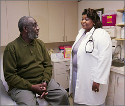 Dr. Sharon Allison-Otty, who campaigns for health literacy, talks with a patient in Fort Washington, Md. A survey found that 29% of the U.S. population has only basic literacy skills, making them unlikely to understand medical jargon.