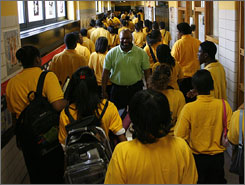 Principal Jeffrey Robinson watches as ninth graders walk to class at Baltimore Talent Development High School.