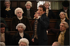 Ioan Gruffudd portrays William Wilberforce, standing center, in the movie Amazing Grace.