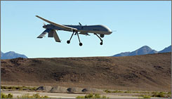 In this 2005 file photograph provided by the U.S. Air Force, an MQ-1 Predator makes its final approach to Indian Springs Auxiliary Field in Nevada.