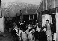Japanese-Americans arrive at the Alien Reception Center in Manzanar, Calif., on March 25, 1942. Some 112,000 were evacuated from their homes in the Pacific Coast area to spend World War II behind barbed wire in relocation camps.