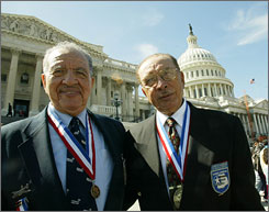Brothers Mitch, left, of Rancho Mirage, Calif., and Robert Higginbotham, of Dana Point, Calif., stand outside the Capitol after being awarded the Congressional Medal of Honor for their service in the Tuskegee airmen.