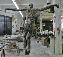 """My Sweet Lord,"" a chocolate statue of a naked Jesus by artist Cosimo Cavallaro hangs at the Ranieris Sculpture Casting studio. It was set to go on display during Holy Week in New York."