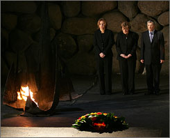 German Chancellor Angela Merkel, center, Israeli Foreign Minister Tzipi Livni, left, and chairman of Yad Vashem Avner Shalev attend a memorial service at the Yad Vashem Holocaust memorial museum in Jerusalem, Sunday. The service commemorates the six million Jews killed by the Nazis during World War II.