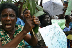Women protest the shooting deaths of activists at Chevron oil facilities in Warri. Nigerians have sued Chevron, saying the company should be held responsible for the deaths of protesters killed by Nigerian security forces outside a refinery owned by its subsidiary.