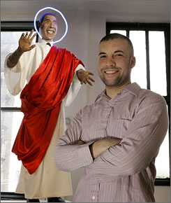 "David Cordero, a student at the School of the Art Institute of Chicago, poses with his life-size statue of Barack Obama entitled ""Blessing"" on Monday, April 2, 2007, in Chicago."