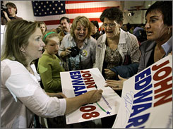 Elizabeth Edwards, wife of presidential candidate John Edwards, autographs posters in Cedar Rapids, Iowa. She has said she's afraid of her neighbor who brandishes a gun.