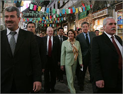 Two Syrian security men, foreground, escorted Pelosi during her tour at a popular market in downtown.