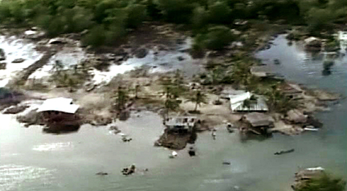 An aerial picture taken Tuesday shows destruction in Gizo, Solomon Islands, after the town was devastated by a tsunami. Thousands of people in Gizo spent Monday night sleeping on a hill behind the town. At least 28 people died as a result of the tsunami.