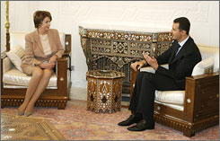 Pelosi and President Assad in Damascus on Wednesday.