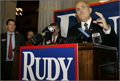 Republican presidential hopeful Rudy Giuliani speaks after picking up the support of South Carolina Treasurer Thomas Ravenel, far left during a news conference, Thursday, April 5, 2007, at the Statehouse in Columbia, S.C.
