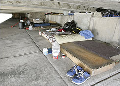 The living areas of two paroled sex offenders living under a bridge beside the intercoastal waterway in Miami is seen Thursday. The men live under the bridge because they can not find housing in compliance with the strict county ordinances that limit where they can live.