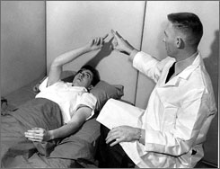Psychiatrist James Ketchum performs a neurological test on a soldier volunteer in an Army chemical weapons program that run until 1972.