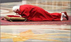 Pope Benedict XVI attends the celebration of the Lord's passion in St. Peter's Basilica Friday in Vatican City. Good Friday services observe the crucifixion and death of Jesus Christ.