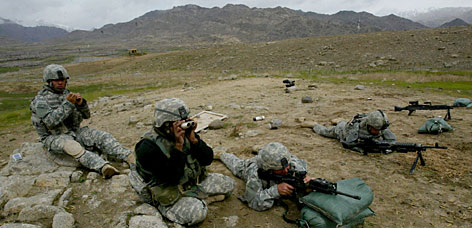 U.S. soldiers of B company, 4th Infantry Regiment practice shooting at Baylough, a forward operating base in Zabul province, southeastern Afghanistan. About 26,000 U.S. soldiers are in Afghanistan presently.