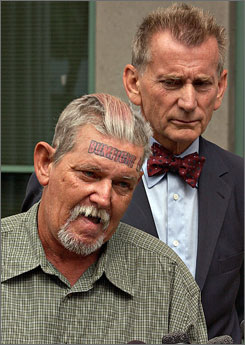 "Donnie Brennan, left, a homeless Army veteran, spoke about the producers of the ""Bumfights"" videos, as attorney Browne Greene stood behind him during an Oct. 2, 2002 news conference outside the Hall of Justice in downtown San Diego."