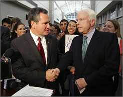 Sen. John McCain, R-Ariz., is endorsed by South Carolina House Speaker Bobby Harrell during a visit to North Charleston. Harrell supported George W. Bush in 2000 over McCain.
