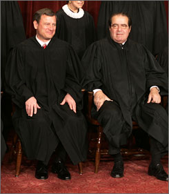 Conservative justices John Roberts, left, and Antonin Scalia have found themselves in tune during court sessions this year.