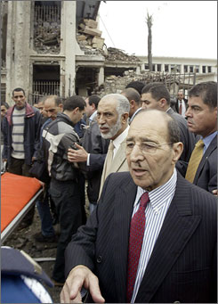 Algerian Prime Minister Abdelaziz Belkhadem, center, and Interior Minister Yazid Zerhouni, front, visit the scene near the Government Palace in the centre of Algiers.