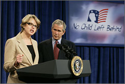 Education Secretary Margaret Spellings speaks about the No Child Left Behind program with President Bush at a charter school in Washington. By law, educators should use scientific methods when determining curriculum, but the science is often inconclusive, politically charged, poorly disseminated or impractical.