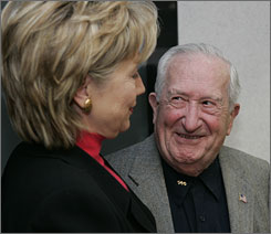 Sen. Hillary Clinton talks with Sam Danial, former state chairman of the Disabled American Veterans, at the Syracuse N.Y. Veterans' Administration Hospital. She visited with patients and met with local civic leaders before speaking on care for our nations veterans.