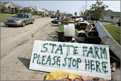 A homeowner's sign asks for an adjuster to check hurricane-damaged property in Slidell, La.