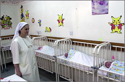 Sister Bushra Gagagan, who manages the Al Hayat private maternity hospital in Baghdad, monitors newborns last week.
