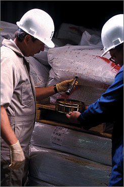 Members of the FDA's Office of Regulatory Affairs import operations group, inspect spices at the port of Baltimore in this 2000 file photo. Just 1.3% of imported fish, vegetables, fruit and other foods are inspected.