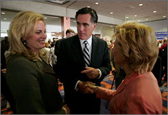 Former Massachusetts Gov. Mitt Romney and his wife Ann, left, greet voters gathered for a Republican Party of Iowa dinner Saturday in Des Moines. Romney and other GOP presidential hopefuls have fallen behind Democrats in fundraising.