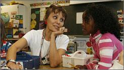 Diana Schmiesing, a 2nd grade teacher at Providence Elementary School, works with Bilan Hajinur, 7. Schmiesing is a member of the 2006 All-USA Teacher Team.