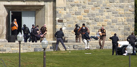 Injured occupants are carried out of Norris Hall at Virginia Tech in Blacksburg, Va., Monday.