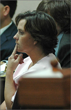 Mary Winkler listens to testimony during her murder trial, in Selmer, Tenn. Winkler is charged with first degree murder in the March 2006 shooting death of her minister husband Matthew Winkler.