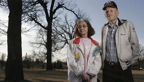 ?Lolly? and Howard Metcalf visit the site where their home once stood in East Grand Forks, Minn.