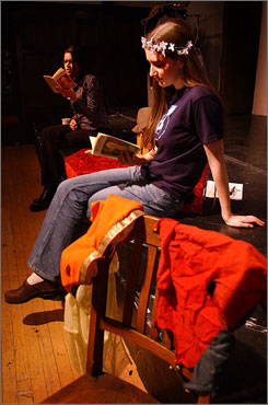"""Wellesley College students Rebecca Floyd, right, and Farida Habeeb read from Shakespeare's """"A Midsummer Night's Dream,"""" as part of a marathon 24-hour reading of the complete works of William Shakespeare. Wellesley is one of the few liberal arts colleges that require a course on the Bard."""