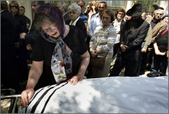 Marlena Librescu weeps over the body of her husband, engineering professor Liviu Librescu, at his funeral in Raanana, Israel, Friday. Librescu was killed in the Virginia Tech shootings Monday.