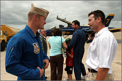 Navy Blue Angel pilot Lt. Cmdr. Kevin J. Davis, left, talks with  University of Oklahoma football coach Bob Stoops in this 2006, photo.