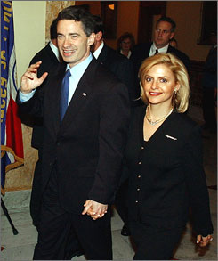 Gov. James McGreevey, left, leaves the assembly chambers at the Statehouse with his wife, Dina Matos McGreevey, in Trenton, N.J. on Feb. 24, 2004.
