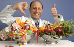 Dr. David Ludwig says children should eat &quot;real&quot; foods such as fruits, vegetables, nuts, cheese and milk, instead of &quot;fake&quot; foods such as candy, soda, white bread and sugar-loaded breakfast cereals.