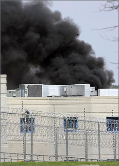 Smoke rises from the New Castle Correctional Facility during a riot at the medium-security men's prison.