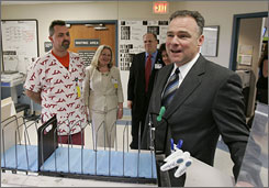 Virginia Gov. Tim Kaine, right, visited the Montgomery Regional Hospital where students wounded in the April 16 shootings remain in Blacksburg, Va. Kaine said today that an executive order might be able to require gun sellers to check counseling records.