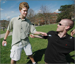 "David Grayson, left, and Ryan Mulligan, juniors at the University of Illinois, demonstrate a ""kill"" in Urbana."