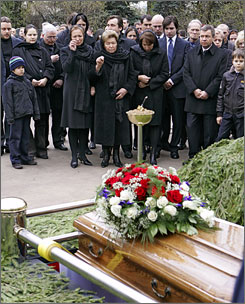Yeltsin's coffin is put into a grave during a funeral ceremony at Novodevichy Cemetery. His widow and two adult daughters cried during the ceremony.