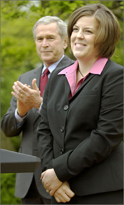 President Bush applauds the 2007 National Teacher of the Year Andrea Peterson of Granite Falls, Wash., at a ceremony in the Rose Garden at the White House on Thursday. She is only the second music teacher to receive the 57-year-old annual award.