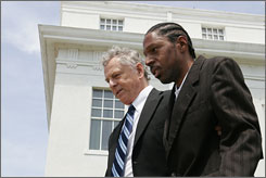 Billy Ray Johnson, right, with lawyer Morris Dees. Johnson's brain was damaged in an attack by white men.