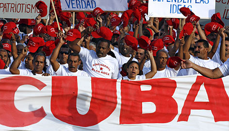 Cuban workers march at Revolution Square in Havana on Tuesday.
